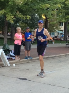 Here I am keeping up an Athletic Walk just past mile 13. I'm forcing a smile.